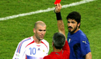 Referee Elizondo of Argentina shows France's Zidane a red card next to Italy's Gattuso during their World Cup 2006 final soccer match in Berlin